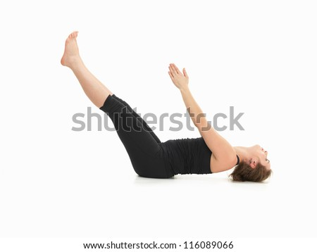 young womanshowing difficult yoga posture, full body side view, dressed in balck on white background