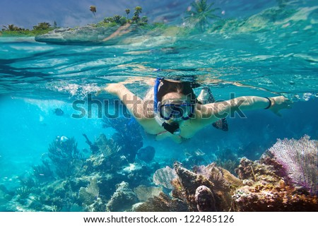 Young women at snorkeling in the tropical water