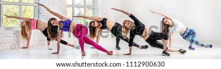 Young women carry out training in dance class. Banner for website.  The concept of sport, dance and a healthy lifestyle.