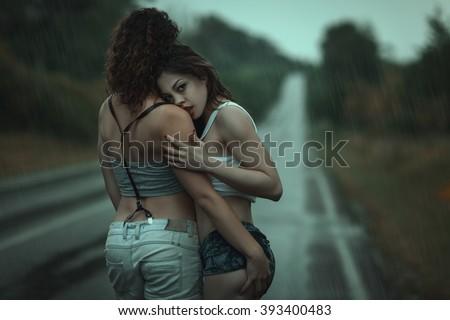 rain Women kissing in the