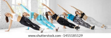 Young women do aerobics in the dance class. Banner for site. The concept of sports, a healthy lifestyle, fitness, stretching and dancing.