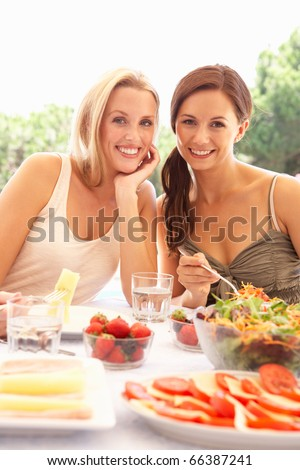 Young women eating outdoors