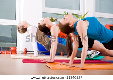 Young women exercising in a step aerobics class