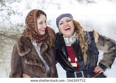 young women funny laughing outdoor in winter