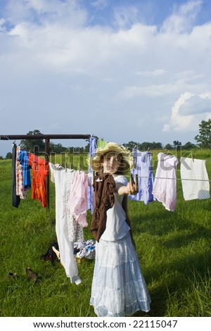 Young women hanging clothes out on the line to dry in the summer