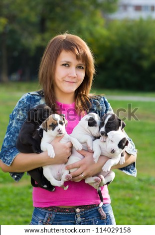 Young Women Holding Five Cute Little Puppies American Staffordshire Terrier