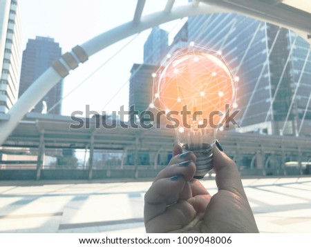 Young women holding light bulb with technology communication connections concept , idea innovation concept #1009048006