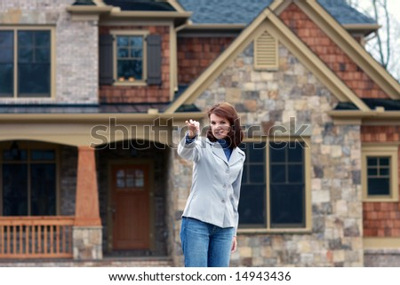 Young Women Holding Out Keys