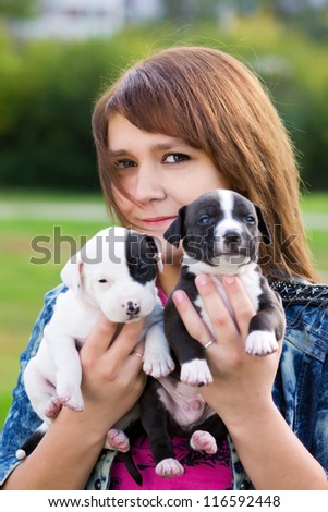 Young Women Holding Two Cute Little Puppies American Staffordshire Terrier