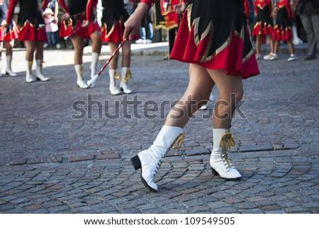 Young women in authentic retro majorette uniform