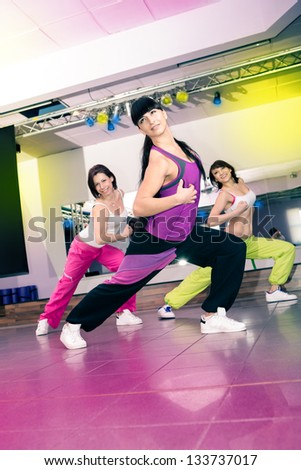 young women in sport dress at an aerobic and zumba exercise