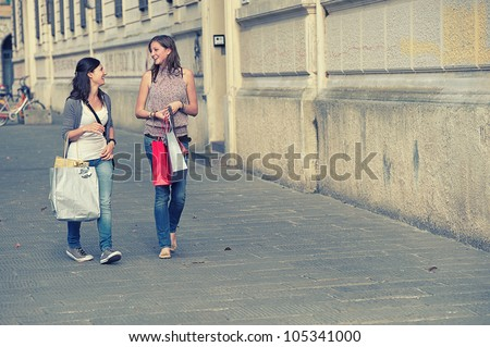 Young Women in the city after Shopping, Italy
