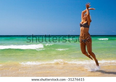 Young women jump on sea beach #31276615