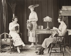 Young women knitting at home