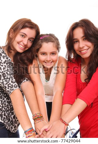 young women of different ages taken from his hand in friendship and sisterhood - stock photo