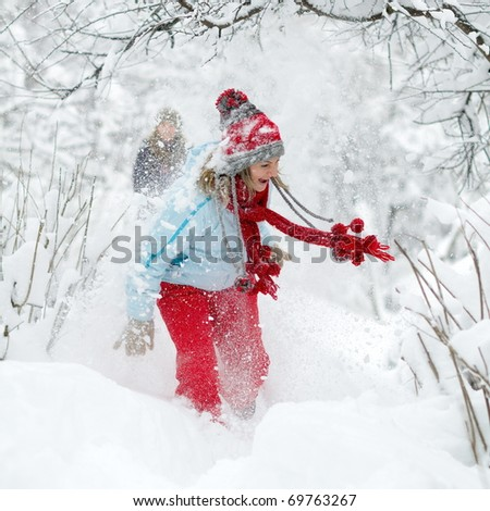 young women outdoor enjoying the snow