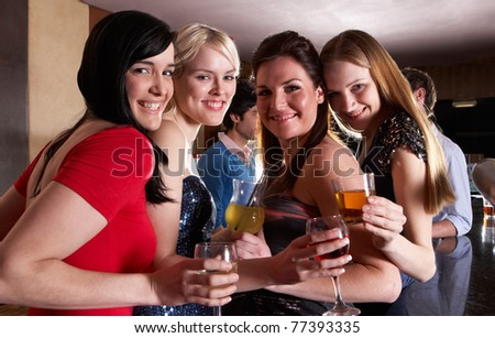 Young women posing at party - stock photo