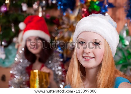 Young women posing for  Christmas portrait at home