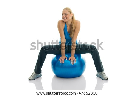 Young women posing on fitness ball. Isolated on white