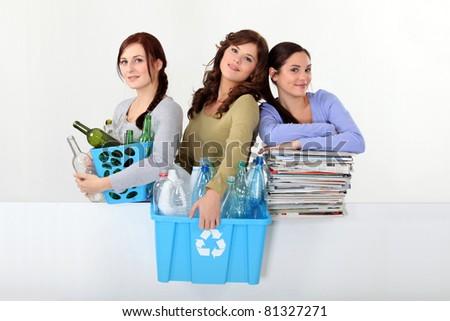 Young women recycling - stock photo