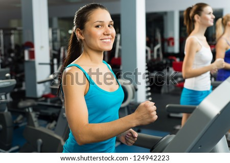young women running on a treadmill, exercise at the fitness club