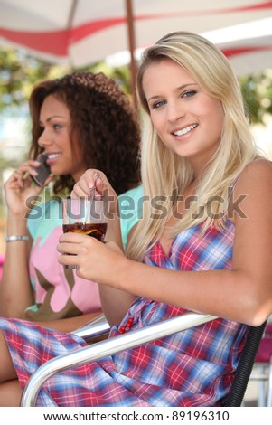 Young women sitting in a cafe