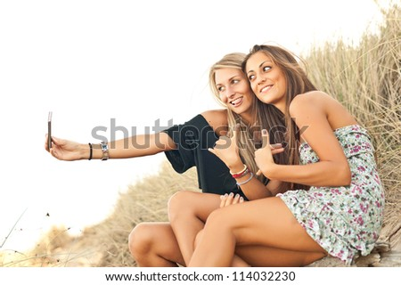 Young women smiling while they're making a photo