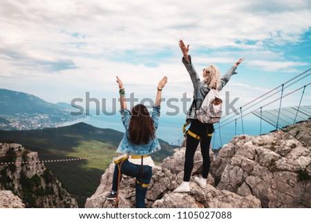 Young women standing io the cliff and enjoying. Crimea, Ai-Petri #1105027088