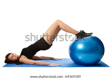 Young women training on a fitness ball. Reverse leg roll exercise. Isolated on white