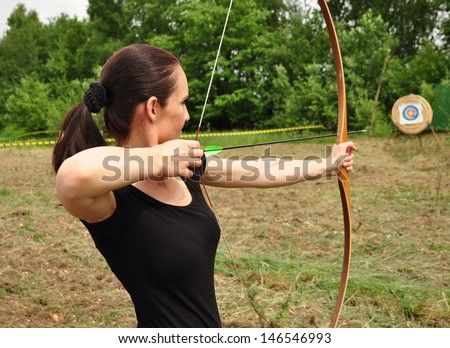 Young women training with the bow