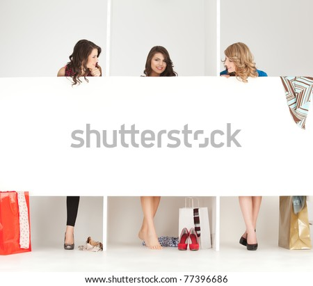 young women trying clothes shop wordrobe