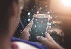 Young women using phones to broadcast live social media concepts, smartphones, social media, social networking concepts with smartphones