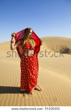 Young women wearing a saree on the Dunes of the Thar Desert, Rajasthan - India