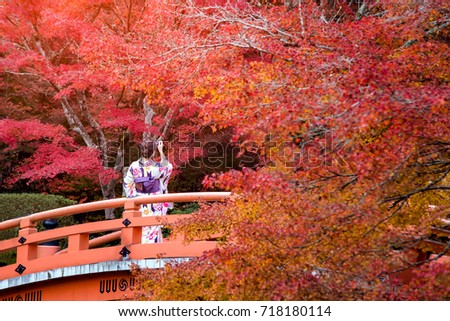 Young women wearing traditional Japanese Kimono at Daigo-ji temple with colorful maple trees in autumn, Famous temple in autumn color leaves and cherry blossom in spring, Kyoto, Japan. Stock photo ©