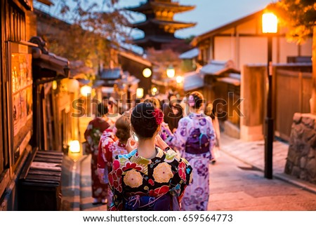 Young women wearing traditional Japanese Kimono at Yasaka Pagoda and Sannen Zaka Street in Kyoto, Japan