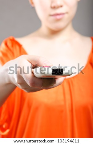 Young women with a remote control