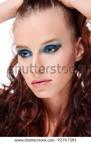 Young women with colorful makeup and red hair