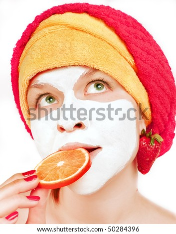 young women with face mask and fruits