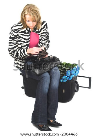 Young women with suitcase ready for travel