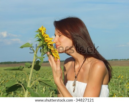 Young women with sunflowers