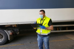 young worker at express courier with Coronavirus protection mask
