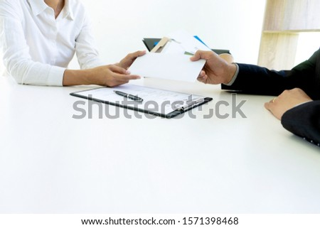 Young worker feel bad and sad, he receive resign note from his boss and company. Sad business man pack his belonging in the box and go back home.