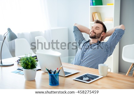 Young worker having break and resting after solving task #458275459