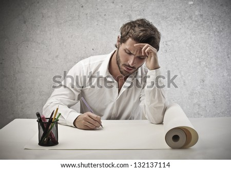 young worker sitting at his desk