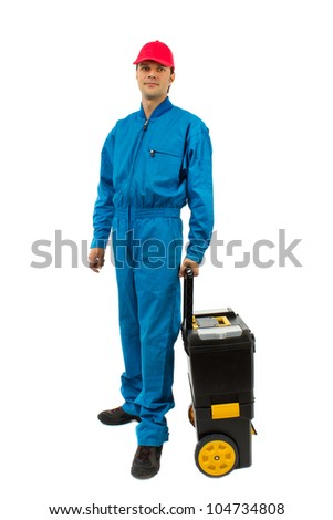 young worker wearing blue equipment tool box with wheels isolated on white