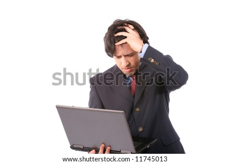 Young worried business man working with laptop, isolated on white background