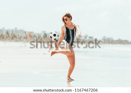 Young wriends playing soccer on the beach #1167467206