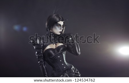 Young yellow eyed witch in black Victorian costume