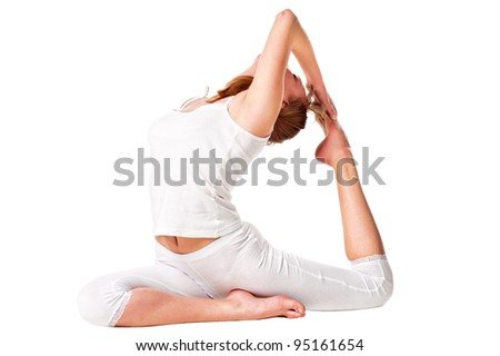 young yoga female doing exercise. Isolated over white