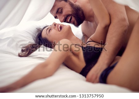 Young young lovers making love in bedroom